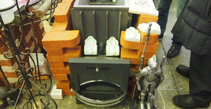 Железная печь обложенная кирпичом